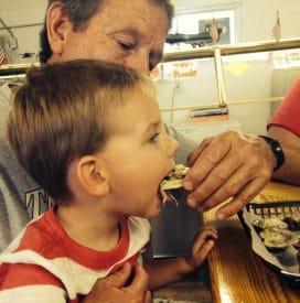 Lynn's Grandson eating a Apalachicola Oyster